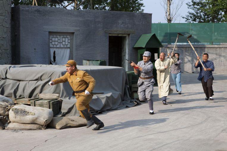 In het Verzetscultuurpark in het district Wuxian wordt een bloederige plaatselijke slag uit de oorlog nagespeeld. Beeld WassinkLundgren