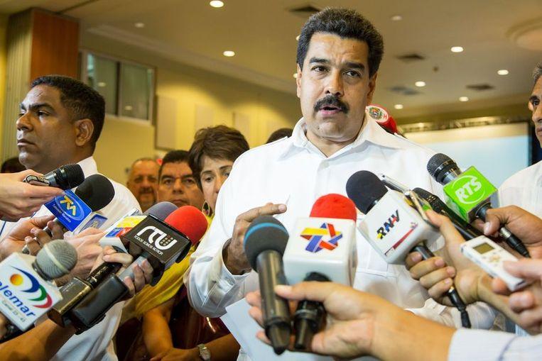 De Venezolaanse president Nicolas Maduro spreekt journalisten toe na afloop van de Unasur-top. Beeld afp