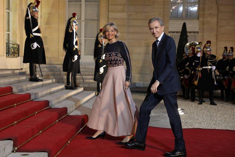 Bernard Arnault en zijn vrouw Helene Mercier-Arnault bij een staatsdiner voor de Chinese president in 2019. Beeld AFP