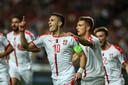 Dusan Tadic juicht na zijn rake penalty na zeven minuten.