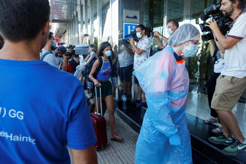Studenten werden eerder deze week verplicht ondergebracht in een hotel, waar ze in quarantaine moesten. Beeld REUTERS