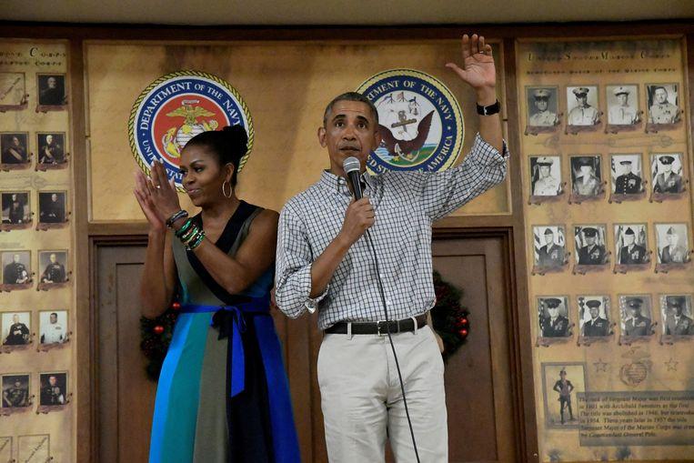Huidig president van de VS Barack Obama samen met zijn vrouw en First Lady Michelle Obama.  Beeld REUTERS