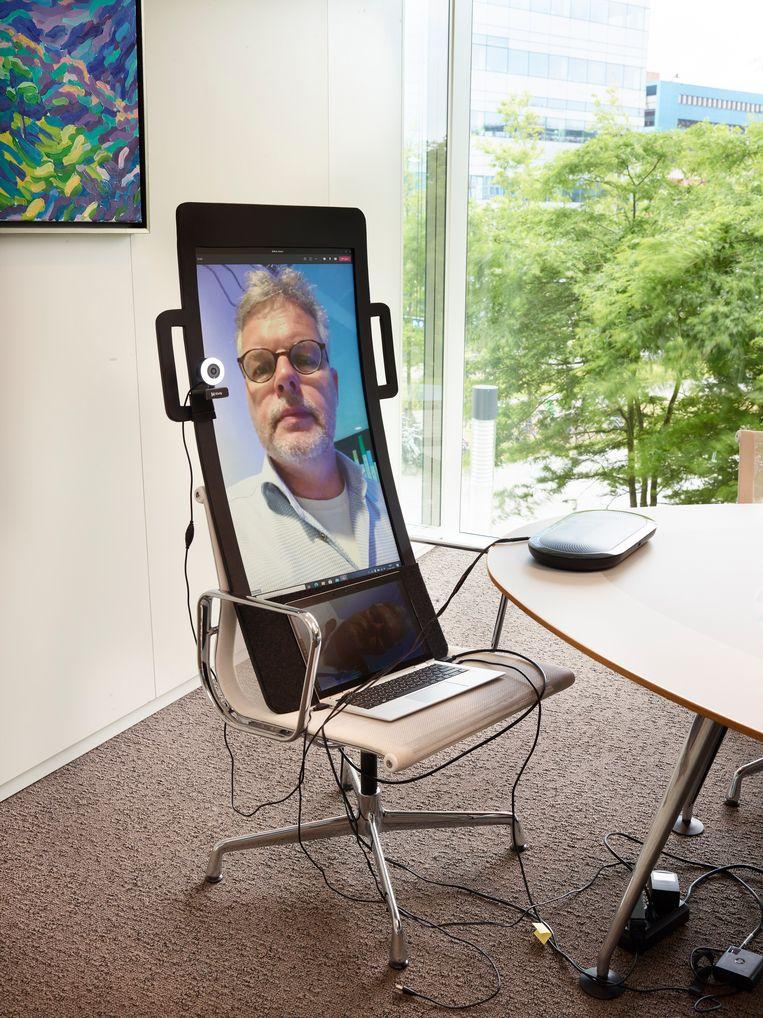 Een thuiswerker kan zo ook op kantoor aanwezig zijn Beeld Henk Wildschut