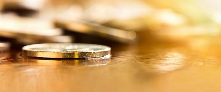 Golden coin closeup - money savings concept