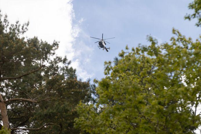 Illustratiefoto: een foto van de politiehelikopter boven het Dilserbos op 19 mei.