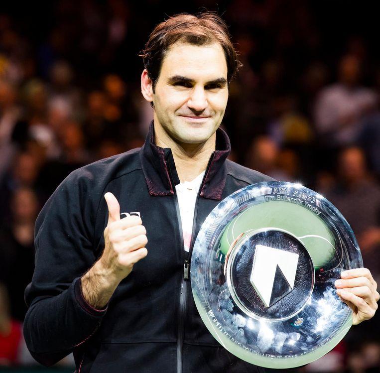 De Zwitser Roger Federer wint zijn partij van de Bulgaar Grigor Dimitrov, in de finale van het ABN AMRO World Tennis Tournament. Beeld anp