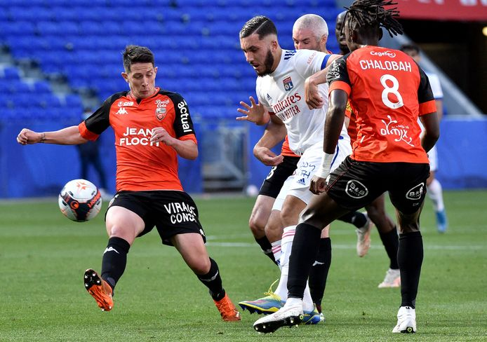 Lyon's French forward Rayan Cherki (C) is challenged by Lorient's French midfielder Laurent Abergel (L) and Lorient's English defender Trevoh Chalobah during the French L1 football match between Olympique Lyonnais and FC Lorient at the Groupama Stadium in Decines-Charpieu, near Lyon, central-eastern France on May 8, 2021. (Photo by JEAN-PHILIPPE KSIAZEK / AFP)