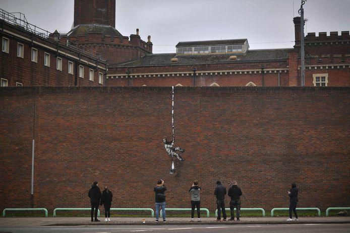 (Een kunstwerk van Banksy op de muur van Reading Gaol