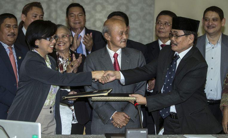 2014 philipijnen: Na jarenlange onderhandelingen is er een vredesakkoord tussen de Filipijnse regering en de grootste islamitische rebellenbeweging, het Moro Islamitische Bevrijdingsfront (MILF). Beeld null