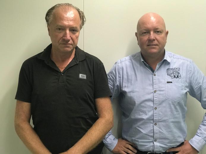 Henk van den Noort en Sjaak Vos (r) van team mensenhandel en -smokkel politie van de Zeeland-West-Brabant