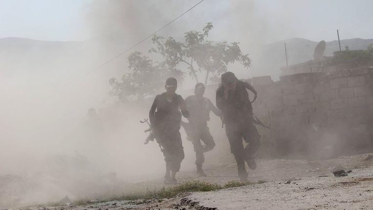 Gevechten tussen rebellen en het leger van president Bashar al-Assad in Syrië. Beeld reuters