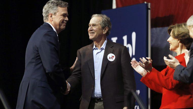 Jeb, George en Laura Bush. Beeld ap