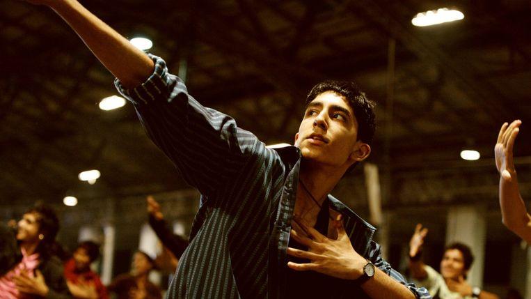 Dev Patel in 'Slumdog Millionaire' van Danny Boyle en Loveleen Tandan. Beeld
