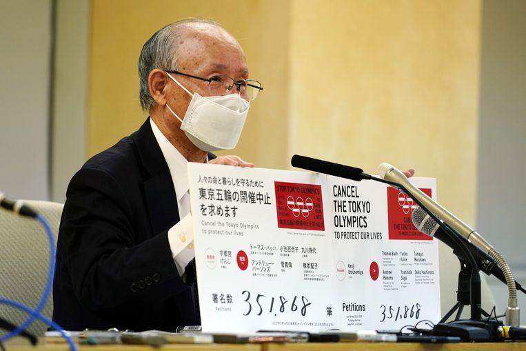 Advocaat Kenji Utsunomiya, de drijvende kracht van de beweging tegen de komst van de Olympische Spelen. Beeld AP
