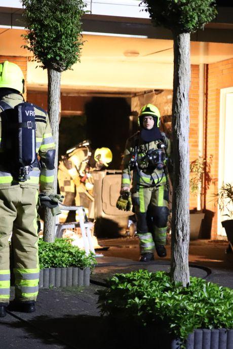 Brand in garage Meteren: veel rook en flinke schade