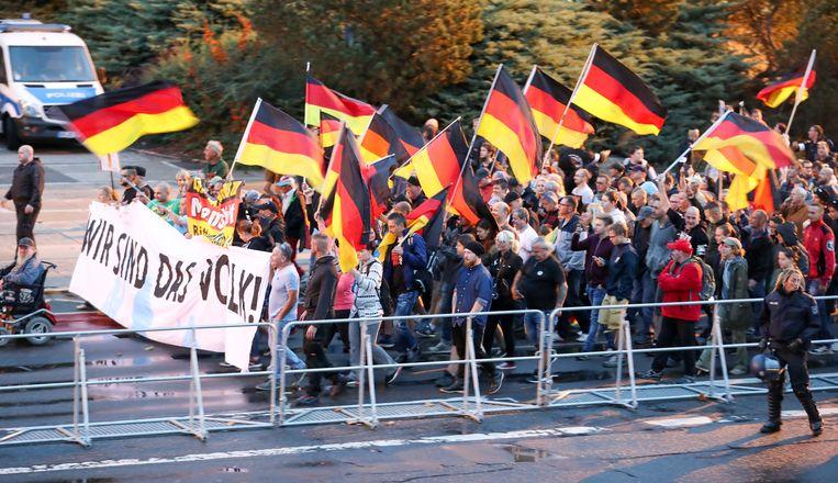 Betogers in Chemnitz. Beeld DPA