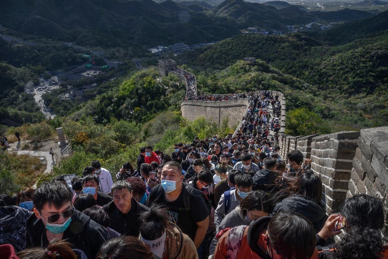 Drukte op de Chinese muur. Beeld Getty Images