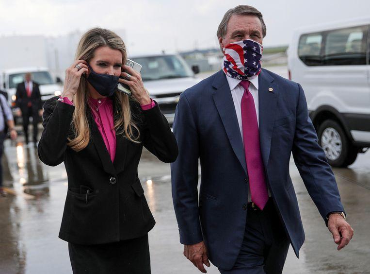 De Republikeinse senatoren Kelly Loeffler en David Perdue, zij zijn er niet in geslaagd om meer dan 50 procent van de stemmen te krijgen in Georgia.  Beeld REUTERS