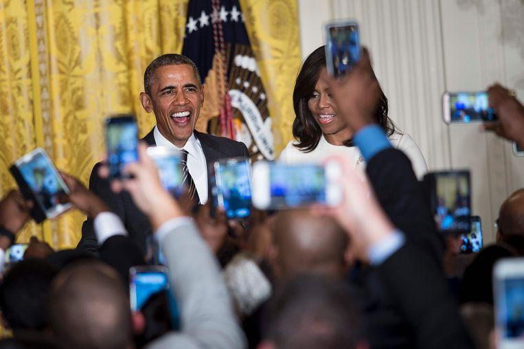 Ex-president Barack Obama en zijn vrouw Michelle tijdens een receptie ter gelegenheid van Black History Month in februari 2018. Beeld AFP