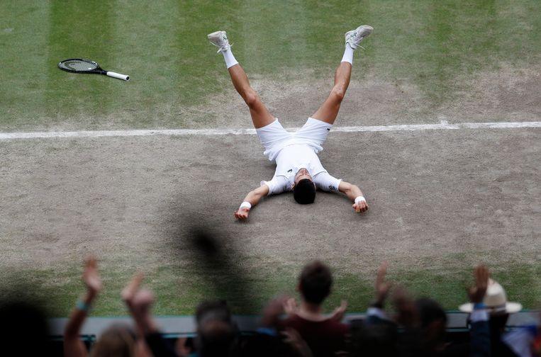 Djokovic viert zijn twintigste grandslamtitel.  Beeld Pool via REUTERS
