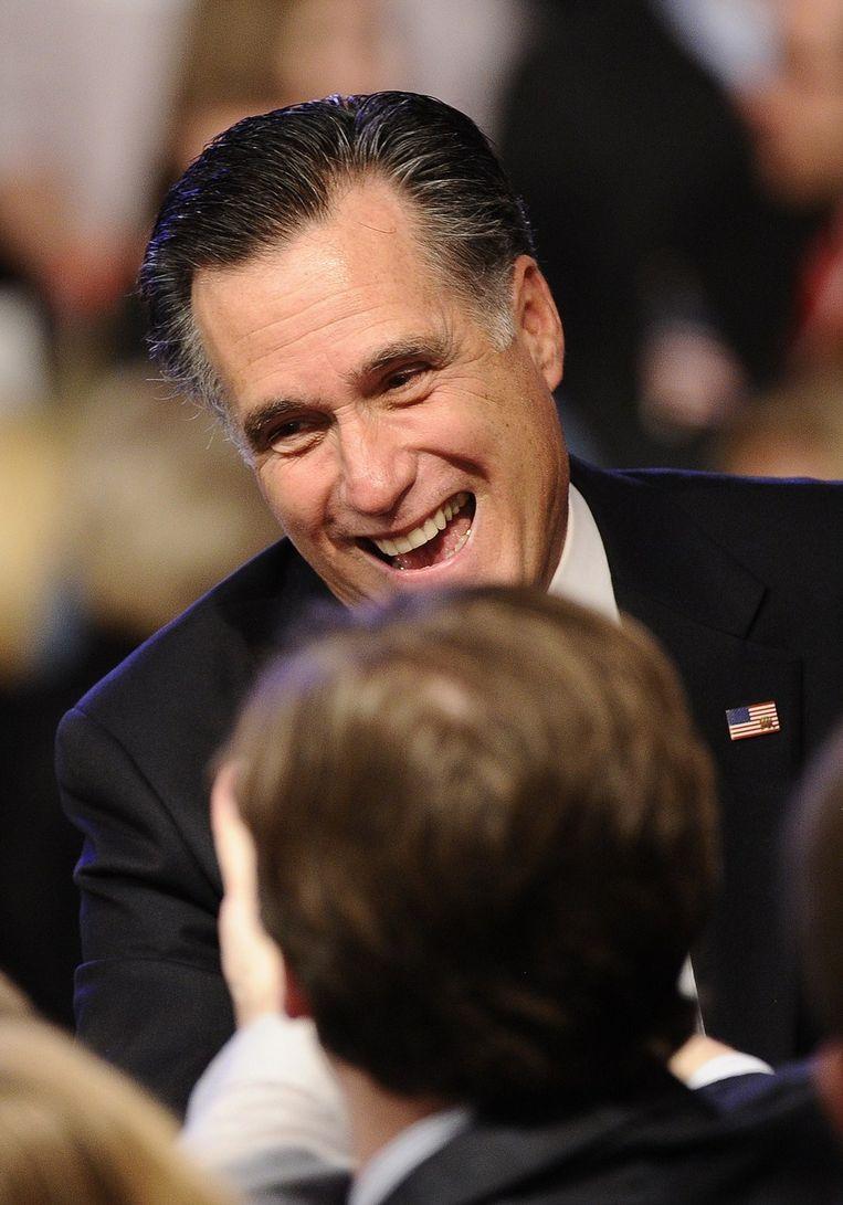 Een glunderende Mitt Romney Beeld AFP