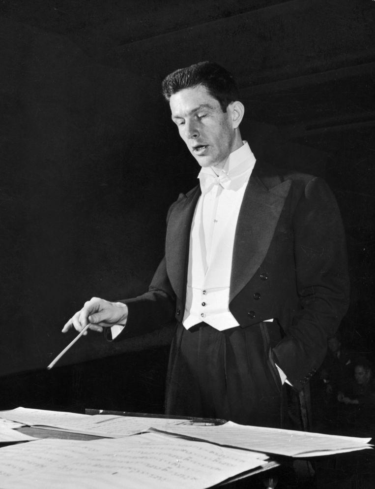 Componist John Cage, een van de grote vernieuwers van de moderne klassieke muziek, tijdens een concert  in 1943 in New York.  Beeld Eric Schaal/Getty Images