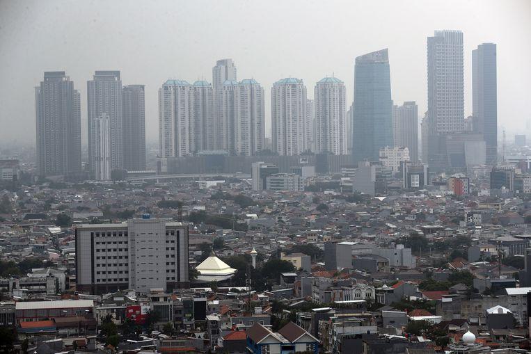 Smog en overstromingen bedreigen de huidige Indonesische hoofdstad Jakarta. Beeld EPA