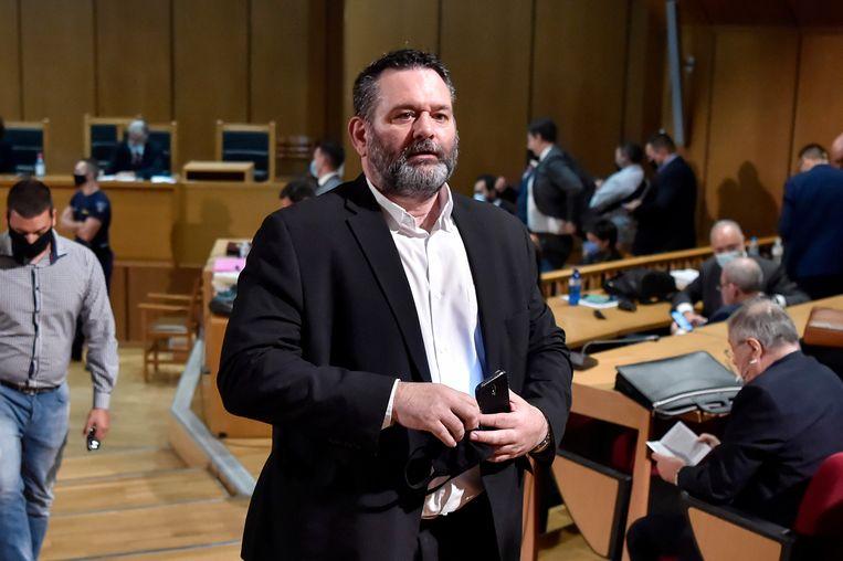 Ioannis Lagos in een Griekse rechtszaal in oktober 2020, waar hij tot dertien jaar cel werd veroordeeld. Beeld AFP