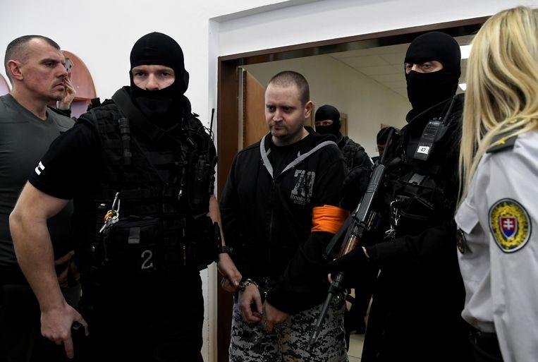 Ex-militair Miroslav Marcek (midden) schoot Ján Kuciak en diens verloofde dood. Beeld REUTERS