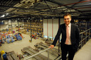 Reesink-directeur Gerrit van der Scheer in het distributiecentrum van het toen nog jonge bedrijf THR.