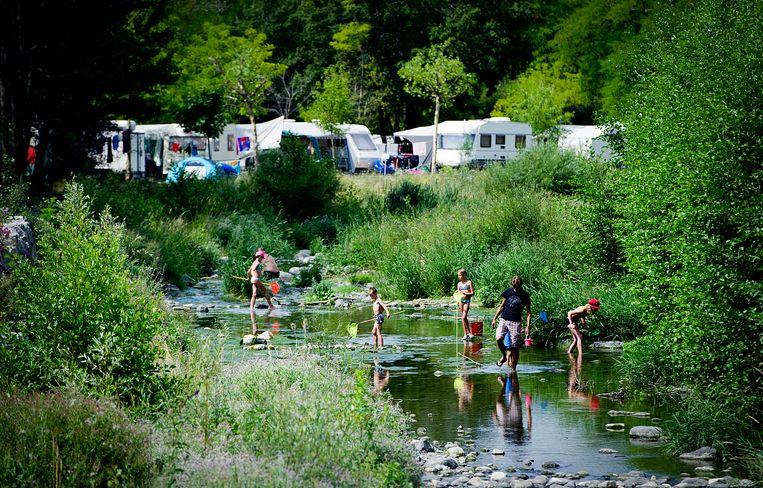 Op de Franse camping Domaine Le Pommier in Villeneuve-de-Berg (Ardèche) verblijven nu al veel Nederlanders. Beeld Hollandse Hoogte /  ANP