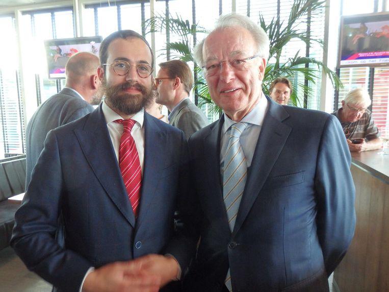 Rabbijn Yanki Jacobs en nog even-burgemeester Jozias van Aartsen. In zijn speech: 'Eric, je bent een mooi mens. Daarom houdt Amsterdam van je.' Beeld Schuim