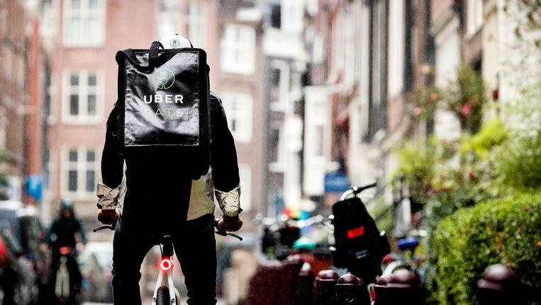 Taxidienst Uber is ook in maaltijdbezorging gestapt Beeld ANP/Koen van Weel