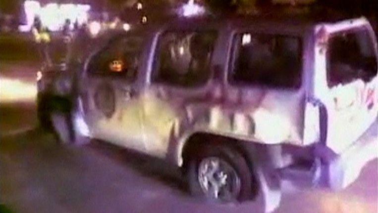 Een videostill van de getroffen auto. Beeld reuters