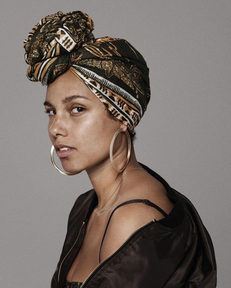Alicia Keys gaat naturel (als je de peperdure serums, laserbehandelingen, massagetherapie en acupunctuur niet meetelt).  Beeld Floris Hoorelbeke