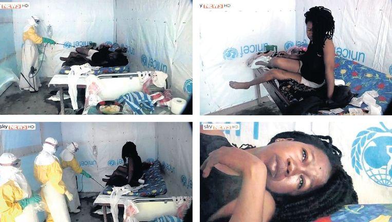 De doodzieke verpleegster Elizabeth Smith wordt door haar collega's bespoten met een desinfecterend middel. Beeld Sky News