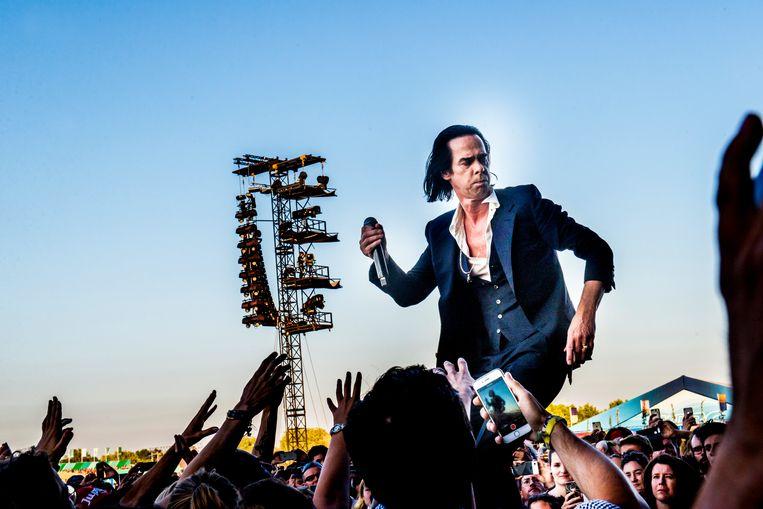 Nick Cave tijdens een optreden op Rock Werchter, in 2018. Beeld Stefaan Temmerman
