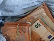 Politie vindt 150.000 euro aan contanten bij huiszoekingen