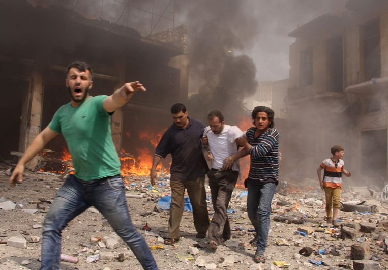 """De Syrische stad Aleppo ligt in puin na bombardementen in 2015. """"Als mensen zeggen dat ze voor de gek zijn gehouden door Russisch nepnieuws en daardoor niet wisten wat er gebeurde tijdens de bombardementen op Aleppo, dan gebruiken ze desinformatie als smoes."""" Beeld AFP"""