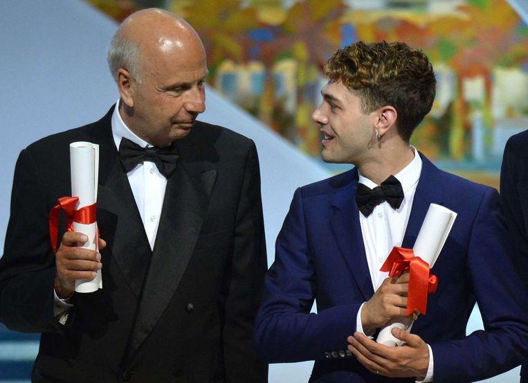 Regisseur Xavier Dolan(rechts)en de Franse filmproducent Alain Sarde. Beeld afp