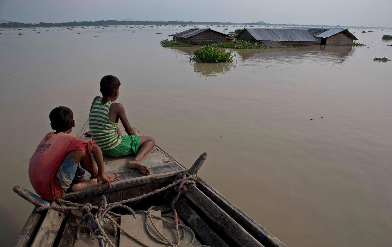 Hevige regens veroorzaken overstromingen in de grensregio van India, Nepal en Bangladesh. Armere regio's zijn het kwetsbaarst voor klimaatverandering.  Beeld Anupam Nath / AP