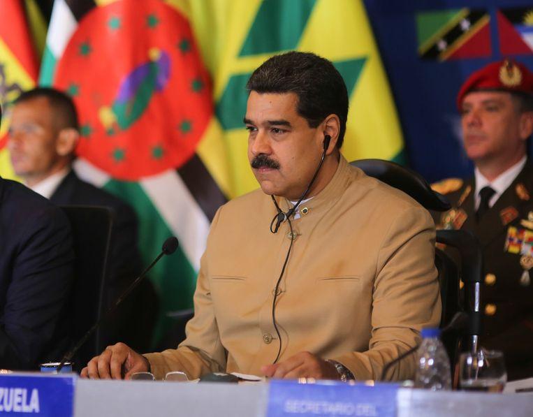 De economische en politieke crisiss in Venezuela is nog acuter geworden na de mogelijk frauduleuze verkiezing van een grondwetgevende vergadering die volgens critici meer macht moet geven aan president Nicolas Maduro (foto). Beeld epa