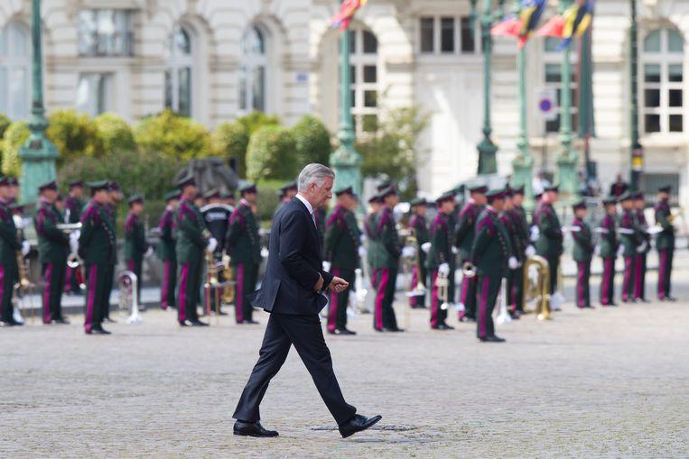Koning Filip dinsdag op het Paleizenplein in Brussel, waar de Belgische nationale feestdag officieel werd gevierd. Beeld BELGA