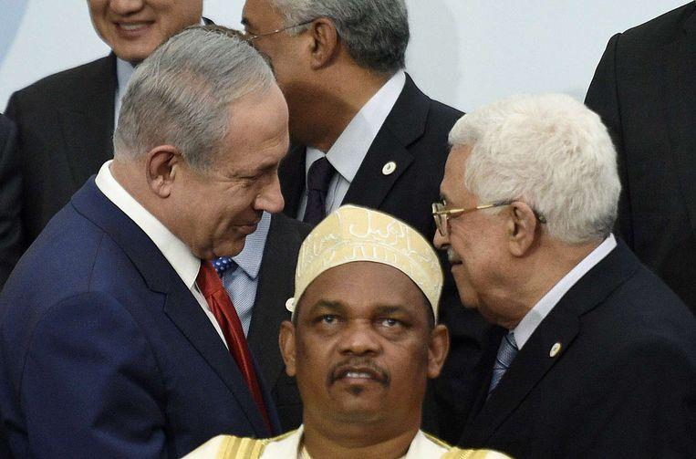Premier Netanyahu en president Abbas. Beeld AFP