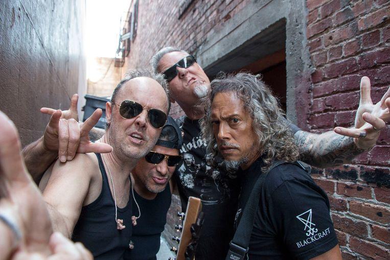 Lars Ulrich, Robert Trujillo, James Hetfield and Kirk Hammett van Metallica bij Rasputin Music op 16 april 2016 in Berkeley, California.  Beeld Getty