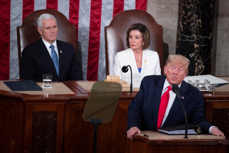 Donald Trump, Nancy Pelosi en Mike Pence. Beeld EPA