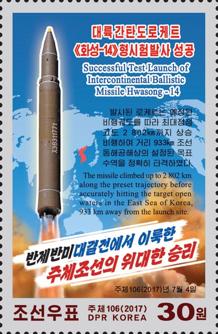 Een Noord-Koreaanse postzegel om de lancering van hun intercontinentale raket te vieren.  Beeld AP