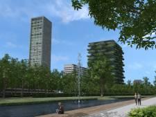 Woontoren Spoorpark Tilburg: lager, groen, met plint