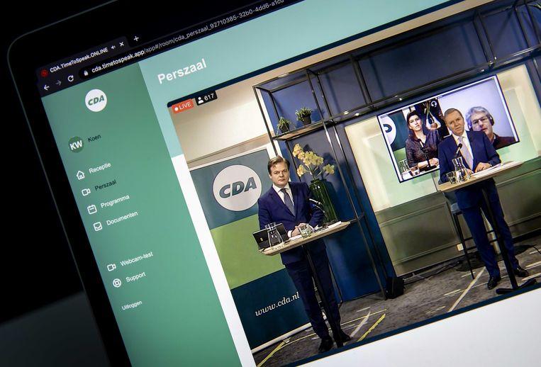 Pieter Omtzigt (l) en CDA-voorzitter Rutger Ploum tijdens het online verkiezingscongres. Beeld ANP