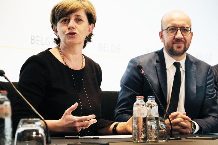 Sophie Dutordoir bij de bekendmaking van haar nieuwe functie, samen met premier Charles Michel. Beeld Tim Dirven